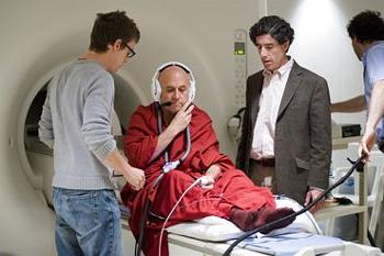 Richard J. Davidson (center wearing jacket) and Antoine Lutz (right) prepare Buddhist monk Matthieu Ricard for MRI test