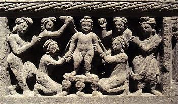 The Buddha as a child, taking a bath. Gandhara, 2nd century CE