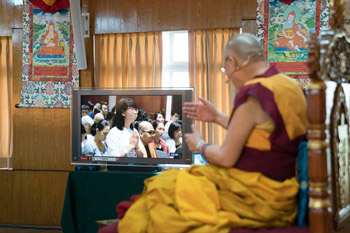The Dalai Lama answering a question from a viewer in Vietnam through a video conference link from his residence in Dhara
