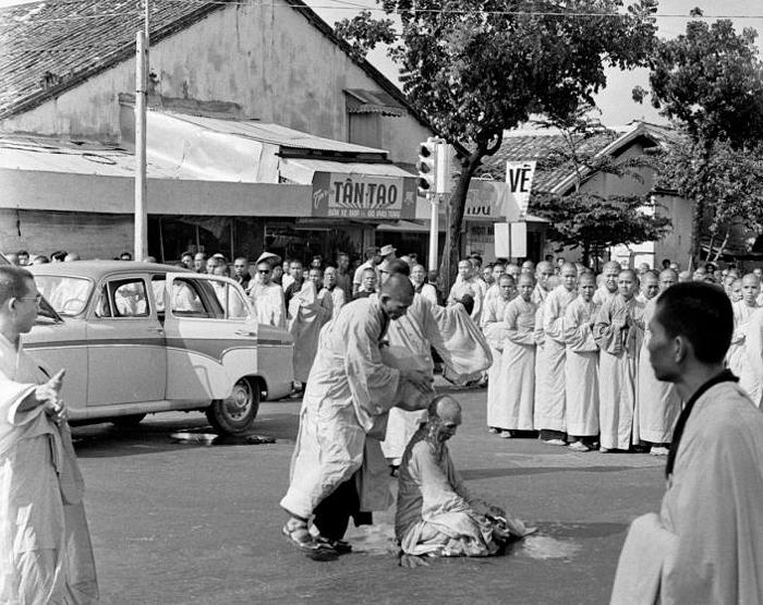 Buddhist monk Quang Duc emerged from a car and sat in the center of the intersection while a younger monk poured gasolin