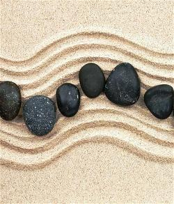 rocks-in-sand-with-ripples