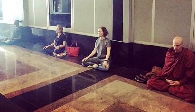 A Buddhist Insights class in a building lobby