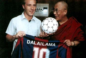 His Holiness the Dalai Lama being presented the jersey of the Tibetan national football team, file photo