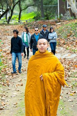 Thich Giac Chinh and yogis group walking meditation