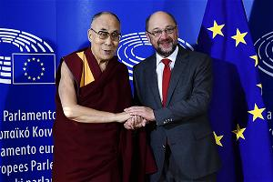 The Dalai Lama (L) is welcomed by European Parliament President Martin Schulz as part of his visit at the European Parli
