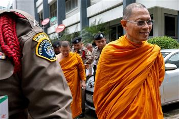 Phra Phrom Dilok, 72, a member of the Sangha Supreme Council is escorted by police officers at the Thai Police Crime Sup