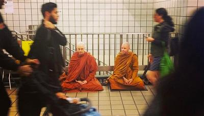 Meditating in a New York subway station. Photos courtesy of Buddhist Insights